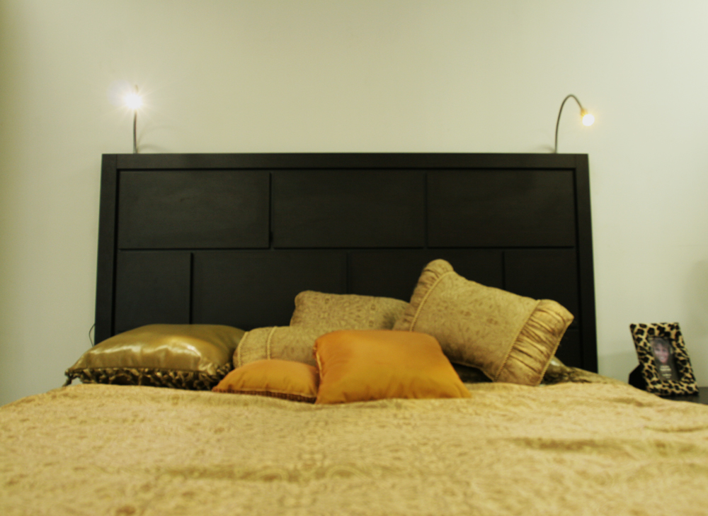 Headboard with adjustable goose-neck lamps
