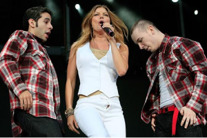 Fergie performs in New Zealand last night with her trouser zip undone