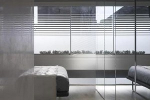 Use mirrors to create depth in a small bedroom